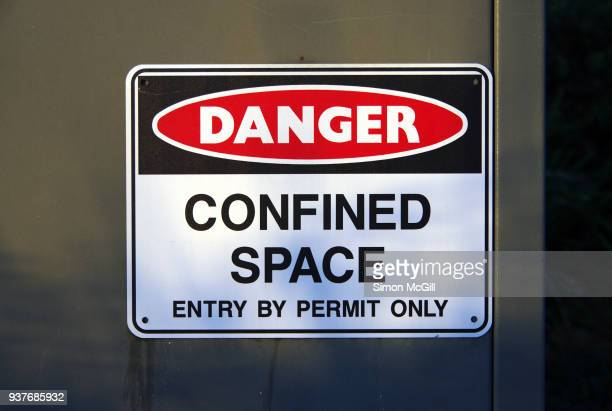 'danger: confined space: entry by permit only' warning sign - confined space stock pictures, royalty-free photos & images