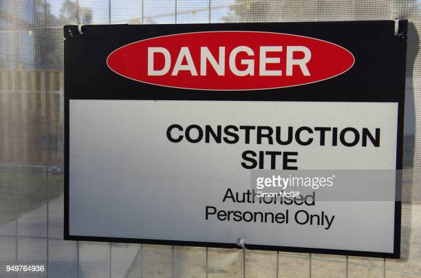 'danger: construction site: authorised personnel only' sign on a building site - permission concept stock pictures, royalty-free photos & images