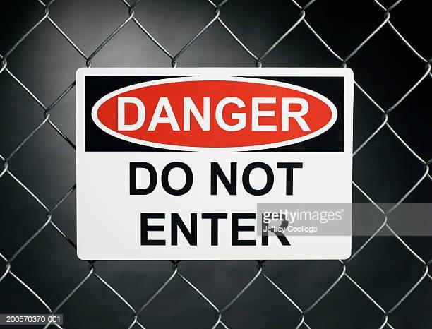 """""""Danger, do not enter sign"""" on fence"""