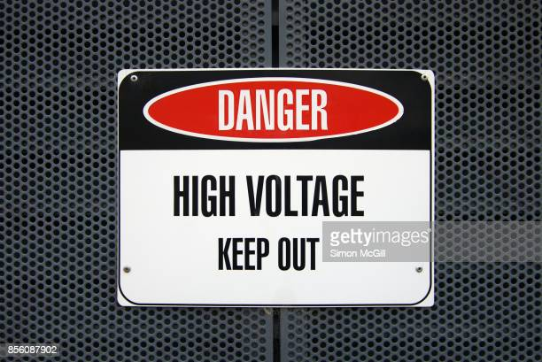 'Danger: High Voltage - Keep Out' sign on a metal housing for electric equipment