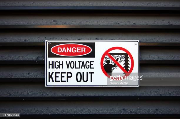 danger: high voltage - keep out sign - warning sign stock pictures, royalty-free photos & images