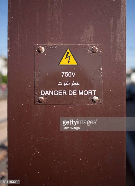 danger high voltage sign in french, casablanca, morocco - jake warga stock pictures, royalty-free photos & images