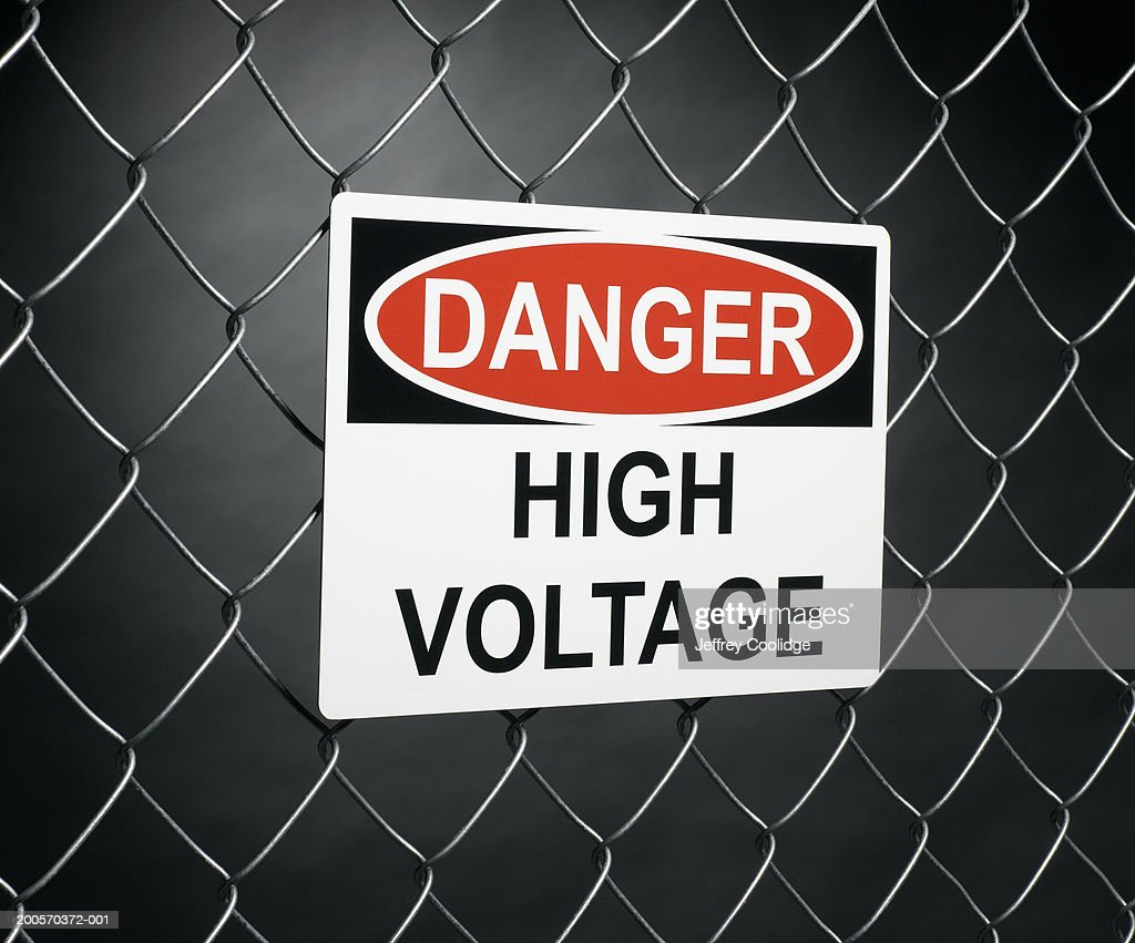 Danger High Voltage Sign On Fence Stock Photo | Getty Images
