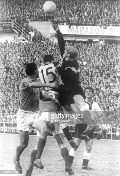 Danger in front of the French goal: French goalkeeper Abbes punches the cross ball into the field before German forward Alfred Kelbassa is able to...