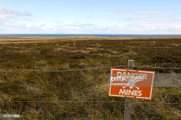 danger minefield with warning sign - land mine stock pictures, royalty-free photos & images