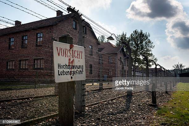 Danger sign at the former electrified perimeter fence at the Auschwitz II memorial and former concentration camp
