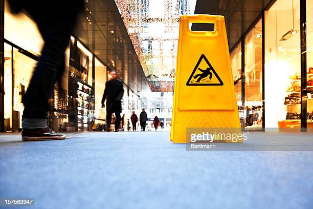 danger sign in a shopping mall - warning sign stock pictures, royalty-free photos & images