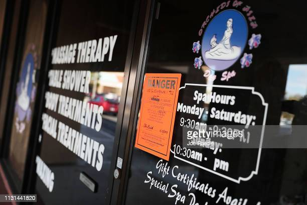 Danger sign is seen on the front door of the Orchids of Asia Day Spa in connection to New England Patriots owner Robert Kraft being charged with...