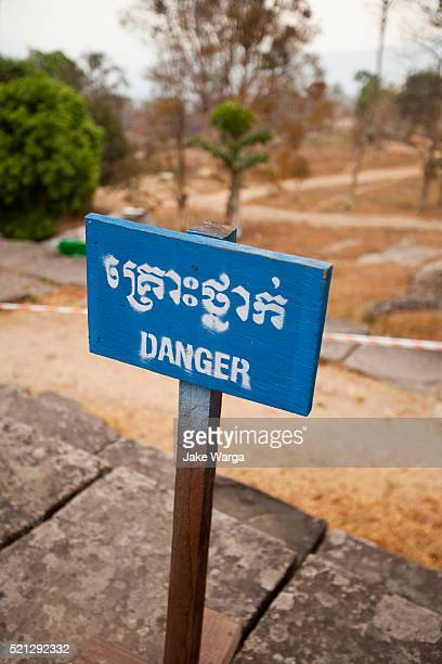 danger sign, preah vihear temple, cambodia - jake warga stock pictures, royalty-free photos & images