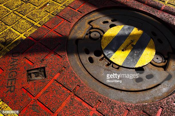 A danger sign sits on the floor beside the covered oil drilling access hole on the Casablanca oil platform operated by Repsol SA in the Mediterranean...