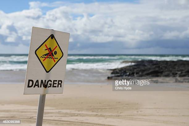Danger signs have been put up along Shelly Beach on February 10 2015 in Ballina Australia Beaches in northern NSW remain closed after Tadashi...