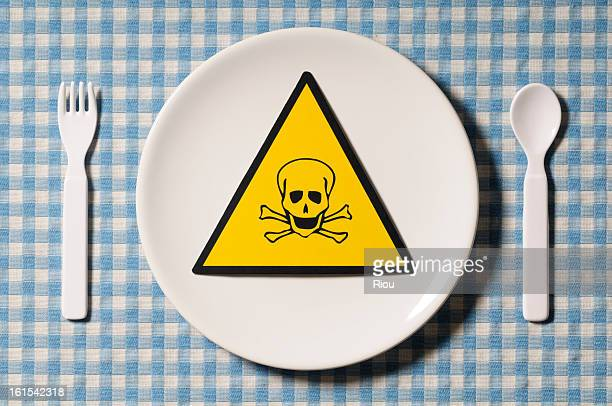 danger symbol on a plate - plastic plate stock photos and pictures