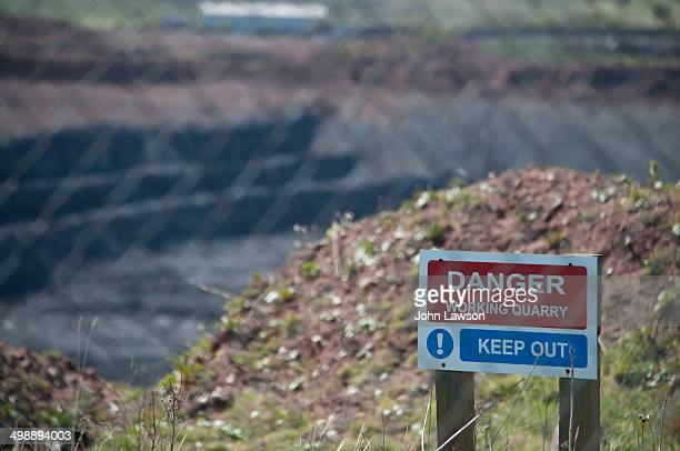 CONTENT] Danger Working quarry Keep out sign with blurred quarry in the background and blurred fence in the foreground Limestone is quarried in...