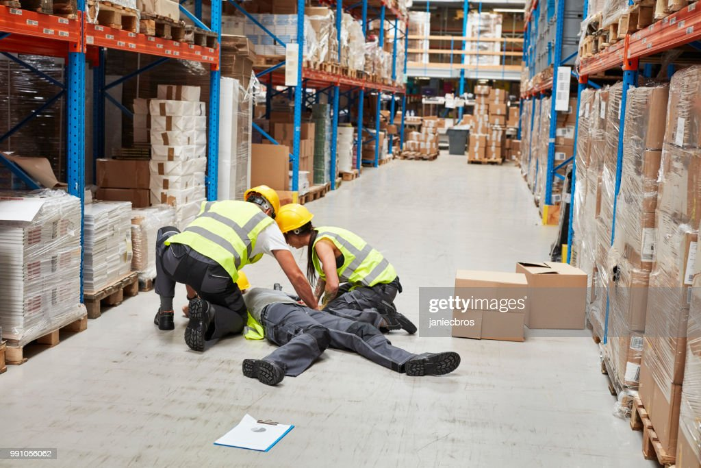 Dangerous accident during work. First aid : Stock Photo