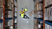 Dangerous accident during work. Warehouse aerial view