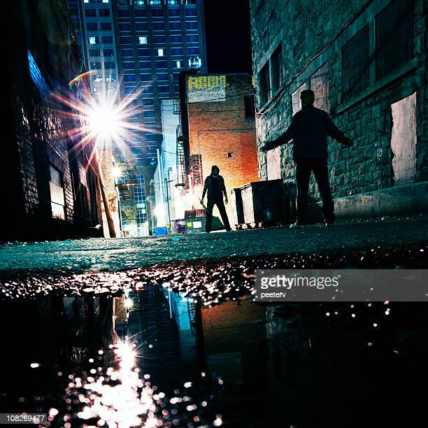 dangerous alley - gang stock pictures, royalty-free photos & images