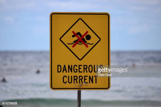 dangerous current beach warning sign - warning sign stock pictures, royalty-free photos & images