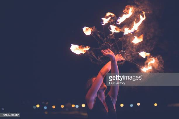 dangerous dance - performer stock pictures, royalty-free photos & images