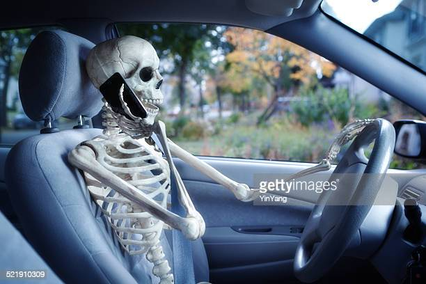 dangerous driver using mobile phone while driving in car - human skeleton stock photos and pictures
