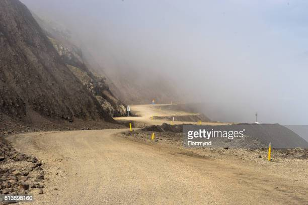 Dangerous gravel road as mountain pass