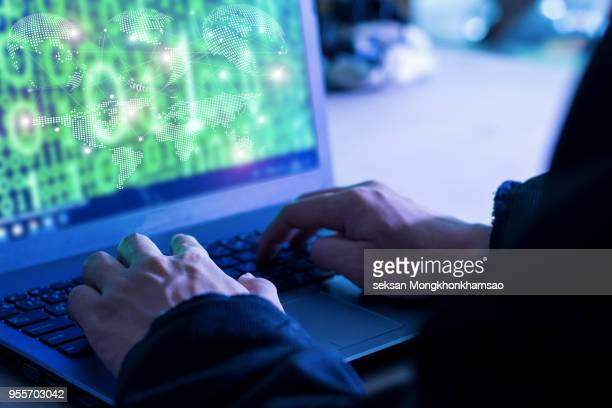 dangerous hooded hacker breaks into government data servers and infects their system with a virus. - data privacy imagens e fotografias de stock