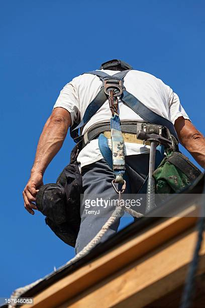 dangerous jobs - safety harness stock photos and pictures