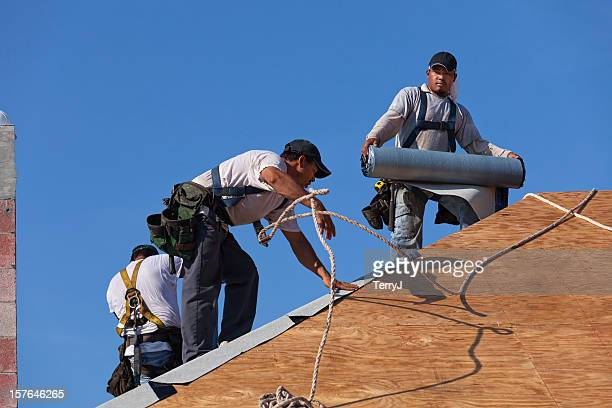 dangerous jobs - safety harness stock pictures, royalty-free photos & images