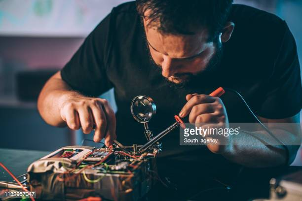 dangerous man making bomb - detonator stock photos and pictures