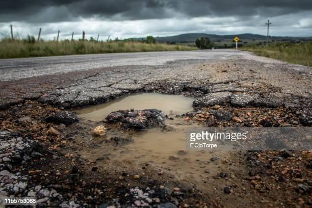 dangerous pothole, road in maldonado department, uruguay - hole stock pictures, royalty-free photos & images