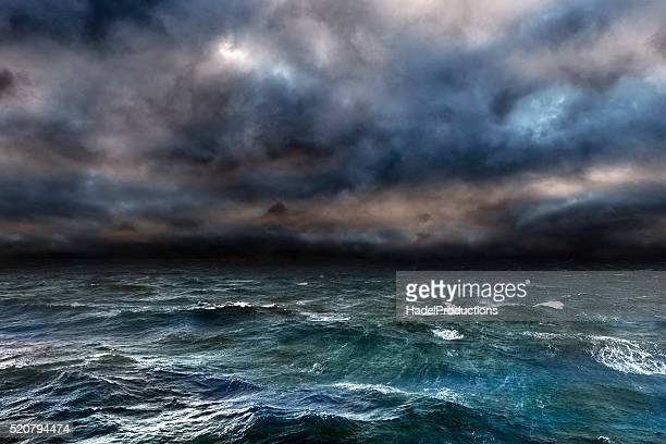 dangerous storm over ocean - gale stock photos and pictures