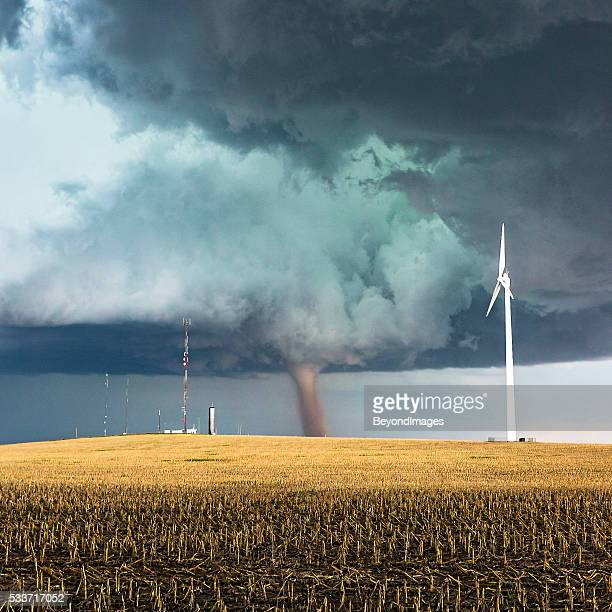 Dangerous tornado with wind generator and telecommunications towers