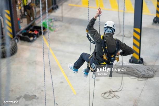 dangerous work - high up stock pictures, royalty-free photos & images