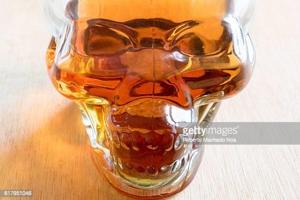 Dangers of drinking alcoholic beverages Skull bottle full of rum