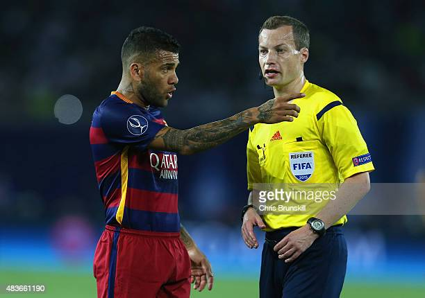 Dani Aleves of Barcelona speaks to Referee William Collum during the UEFA Super Cup between Barcelona and Sevilla FC at Dinamo Arena on August 11,...