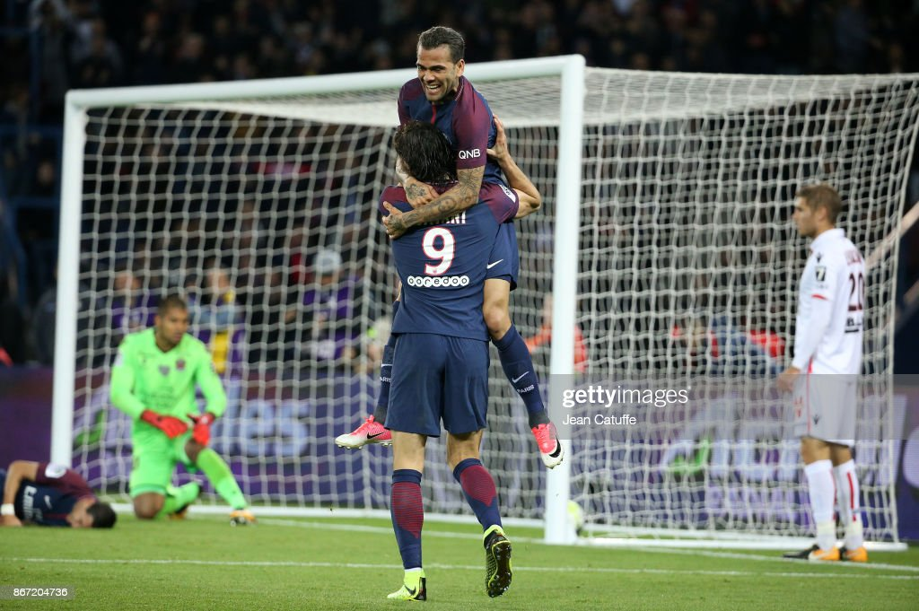 Dani Alves aka Daniel Alves and Edinson Cavani of PSG celebrate the third goal during the French Ligue 1 match between Paris Saint-Germain (PSG) and OGC Nice at Parc des Princes stadium on October 27, 2017 in Paris, France.