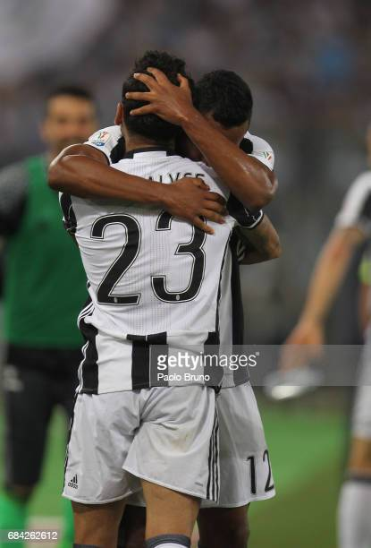 Dani Alves and Alex Sandro of Juventus FC celebrates after scoring the opening goal during the TIM Cup Final match between SS Lazio and Juventus FC...