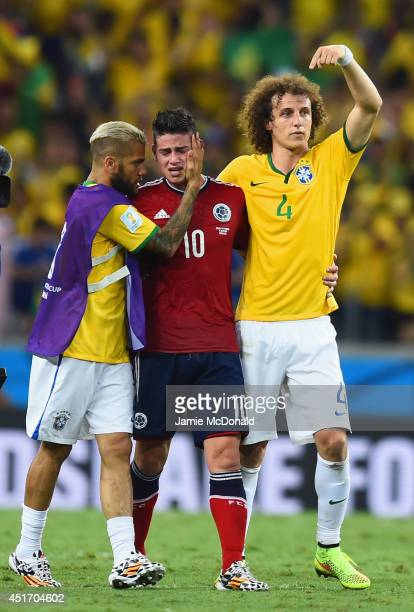 Dani Alves and David Luiz of Brazil console James Rodriguez of Colombia after Brazil's 21 win during the 2014 FIFA World Cup Brazil Quarter Final...