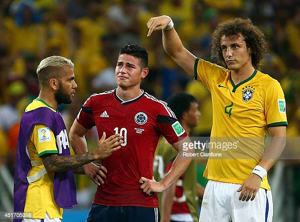 Dani Alves and David Luiz of Brazil console James Rodriguez of Colombia after Brazil's 2-1 win during the 2014 FIFA World Cup Brazil Quarter Final...