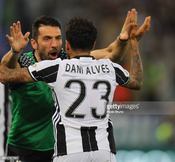 Dani Alves and Gianluigi Buffon of Juventus FC celebrates after scoring the opening goal during the TIM Cup Final match between SS Lazio and Juventus...