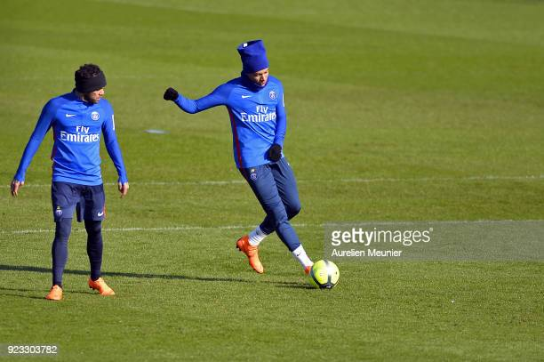 Dani Alves and Kylian Mbappe warm up during a Paris SaintGermain training session at Centre Ooredoo on February 23 2018 in Paris France