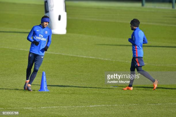 Dani Alves and Marquinhos warm up during a Paris SaintGermain training session at Centre Ooredoo on February 23 2018 in Paris France