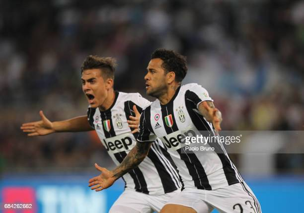 Dani Alves and Paulo Dybala of Juventus FC celebrates after scoring the opening goal during the TIM Cup Final match between SS Lazio and Juventus FC...