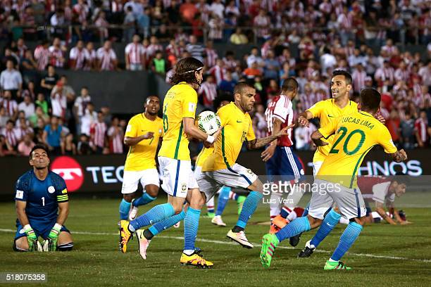 Dani Alves and players of Brasil celebrate after scoring the tying goal during a match between Paraguay and Brazil as part of FIFA 2018 World Cup...