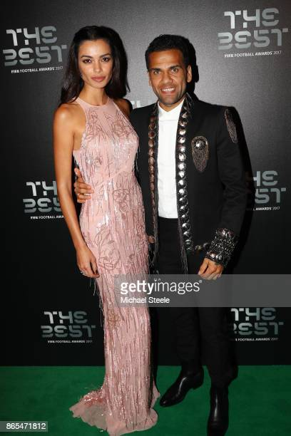 Dani Alves and wife Joana Sanz arrives for The Best FIFA Football Awards Green Carpet Arrivals on October 23 2017 in London England
