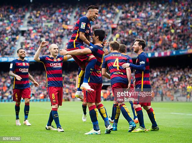 Dani Alves Andres Iniesta Neymar Santos Jr Ivan Rakitic and Lionel Messi of FC Barcelona celebrate with their teammate Luis Suarez after scoring his...