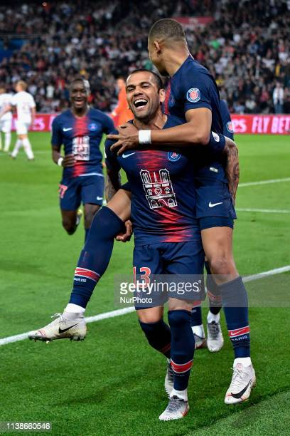 Dani Alves carries Killian Mbappe to celebrate a goal during the french Ligue 1 match between Paris SaintGermain and AS Monaco at Parc des Princes...
