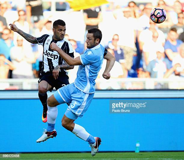 Dani Alves Da Silva of Juventus FC competes for the ball with Stefan De Vrij of SS Lazio during the Serie A match between SS Lazio and Juventus FC at...