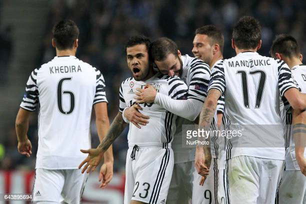 Dani Alves defender of Juventus FC celebrates after scoring goal with teammates during the UEFA Champions League Round of 16 1st leg soccer match...