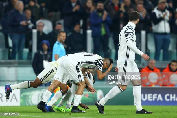 Dani Alves Juan Cuadrado and Paulo Dybala of Juventus special celebration after the penalty of 10 during the UEFA Champions League Round of 16 second...