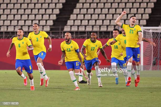 Dani Alves, Malcom, Henrique Matheus, Bruno Guimaraes and Gabriel Martinelli of Team Brazil celebrate their side's victory in the penalty shoot out...